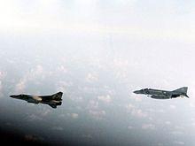 Golf of Sidra incident August 1981: A U.S. Navy McDonnell F-4J Phantom II escorting a Libyan Mikoyan-Gurevitch, M i G-23.