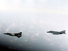Golf of Sidra incident August 1981: A U.S. Navy McDonnell F-4J Phantom II escorting a Libyan Mikoyan-Gurevitch, M i G-23.