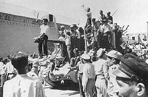 1953, Iranian coup d'état. Overthrowing the democratically elected prime minister Mohammad Moraddegh replaced by an absolute monarch, Shah Reza Palhavi.  Tehran men celebrate the coup. (from Wikipedia)
